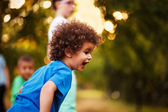 Cute mixed race boy, in park — Stock Photo