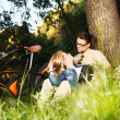 Young caucasian man and woman enjoying in nature — Stockfoto
