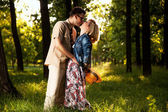 Romantic couple walking in park — Stock Photo