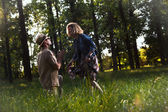 Caucasian blonde man and woman in nature,on sunset — Stock Photo