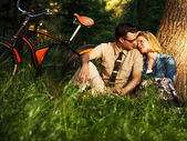 Young caucasian man and woman enjoying in nature — Stock Photo