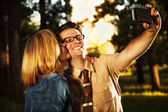Caucasian young adults in park at sunset — Stock Photo