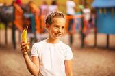 Teenage girl and banana — Stock Photo