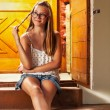 Caucasian girl chilling on wooden house porch — Stock Photo #49855197