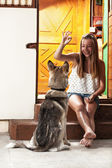 Teenage girl feeding dog — Stock Photo