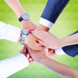 Teamwork,holding hands,handshake,business background — Stock Photo #31991073