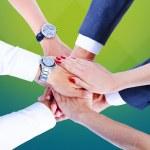 Teamwork,holding hands,handshake,business background — Stock Photo #31991089
