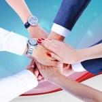 Teamwork,holding hands,handshake,business background — Stock Photo #31991253