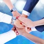 Teamwork,holding hands,handshake,business background — Stock Photo #31991325