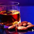 Whiskey and almonds - Stock Photo