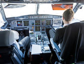 Captain and Co Pilot in Cockpit preparing for Take Off — Stock Photo