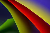 Abstract colored paper background stacked in curved shape — Stock Photo