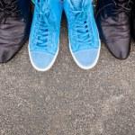 Blue sneakers on asphalt — Stock Photo #17883095