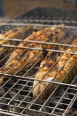 Fresh fishes on the BBQ — Stock Photo