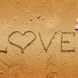 Royalty-Free Stock Photo: Love written in sand