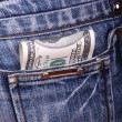 Dollars in jeans pocket — Stock Photo