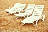 Beach chairs on the sand — Stok fotoğraf