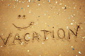 """Vacation"" written in the sand on the beach — Stock Photo"