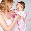 Young mother hugging baby. Happy Family — Stock Photo