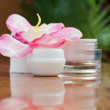 Container of cosmetic moisturizing cream with pink orchid — Stock Photo