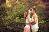 Young attractive couple in love kissing outdoors. Love concept — Stock Photo