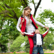 Happy family having fun in park — Stock Photo #29880697