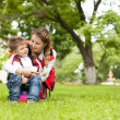 Stock Photo: Happy family having fun in park