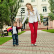 Happy family having fun in park — Stockfoto