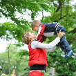 Happy mother and her son playing at the park - family concepts — Stock Photo