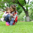 Happy mother and her son resting at the park. Family concept. — Stock Photo