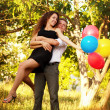 Young couple in love outdoors looking happy — Stock Photo
