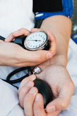 Blood pressure gage in a doctor's hands — Stock Photo