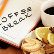 Coffee break written in the notebook — Stock Photo
