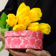 Man in suit with flowers and gift box — Stock Photo #34308695