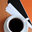 Cup of coffee on the table — Stock Photo