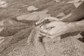 Man with sand in hands — Stock Photo