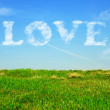 Love in blue sky. Love word with cloudy text effect. — Stock Photo
