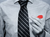 Businessman holding red dart stick. Business concept — Stock Photo