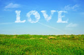 Love in blue sky. Love word with cloudy text effect. — Stockfoto