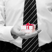 Male hands with gift box — Stock Photo