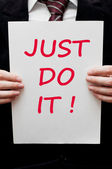 Just do it!  Motivational slogan — Stock Photo