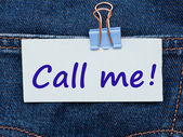 Note with message Call Me written on it on jeans pocket — Foto Stock