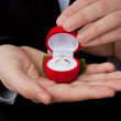 Engagement ring in hands — Stock Photo #42179079