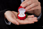 Engagement ring in hands — Stock Photo