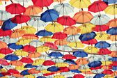 Colorful umbrellas in the sky — Stock Photo
