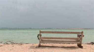 Bench at the ocean on Bonaire, Netherlands Antilles — Stock Video
