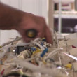 Hands of a man handling complicated wiring — Stock Video