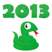 Rice paper cut cute cartoon green snake with 2013 — Stock Photo