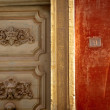 Antique portal and red wall — Stockfoto #12795740