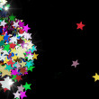 Stock Photo: Colorful stars on black background